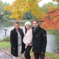 Autumn picture of parents and daughter